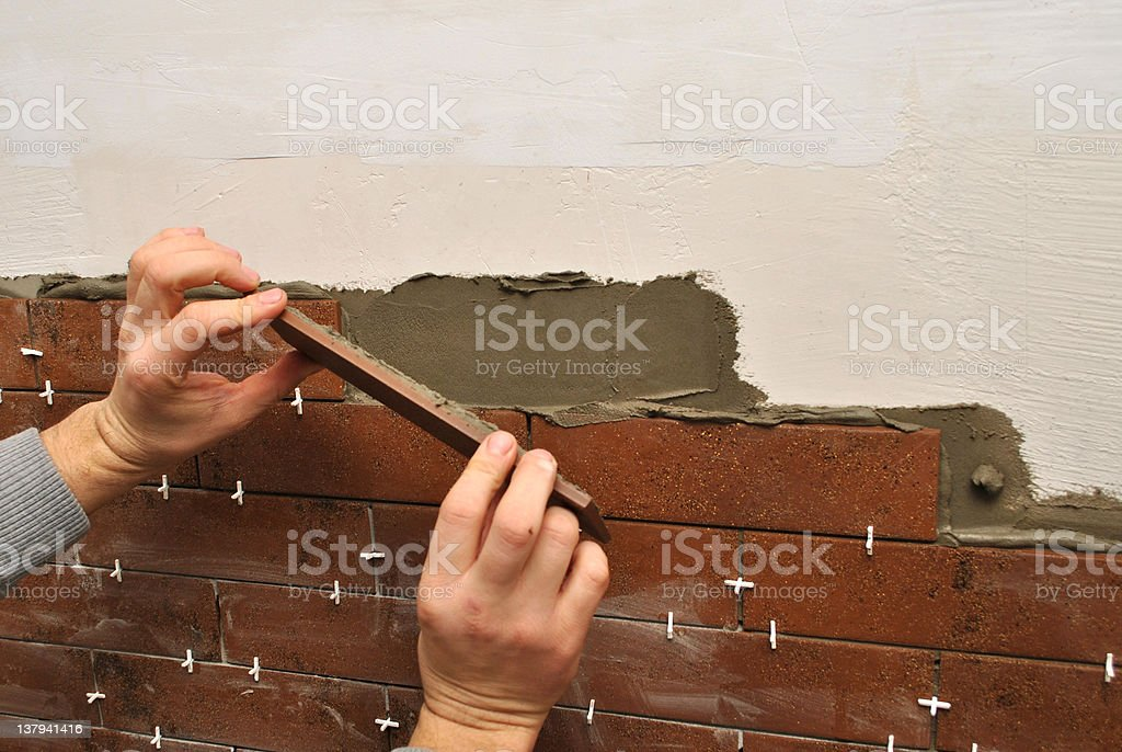 Laying Ceramic Tiles royalty-free stock photo
