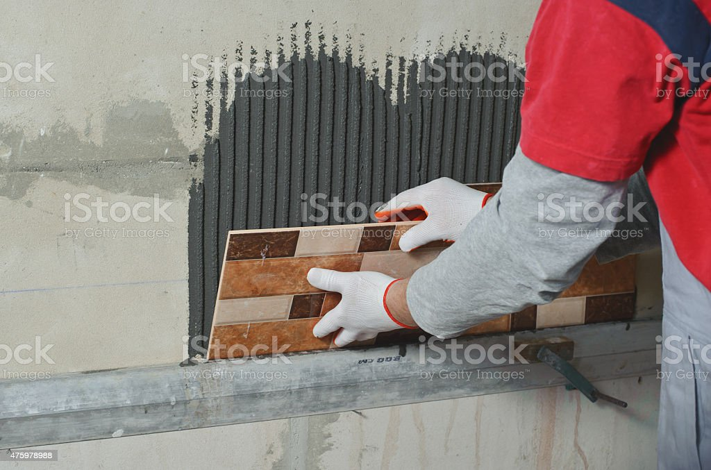 Laying Ceramic Tiles. stock photo