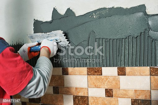 istock Laying Ceramic Tiles. 534471147