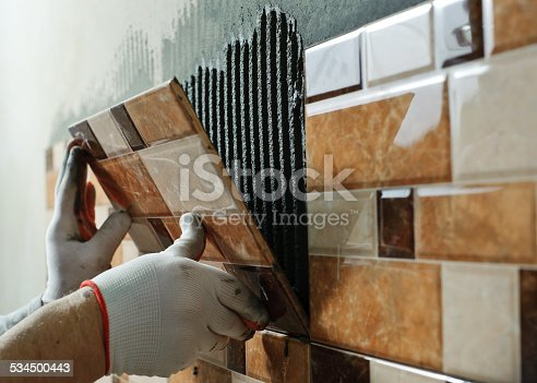istock Laying Ceramic Tiles. 534500443