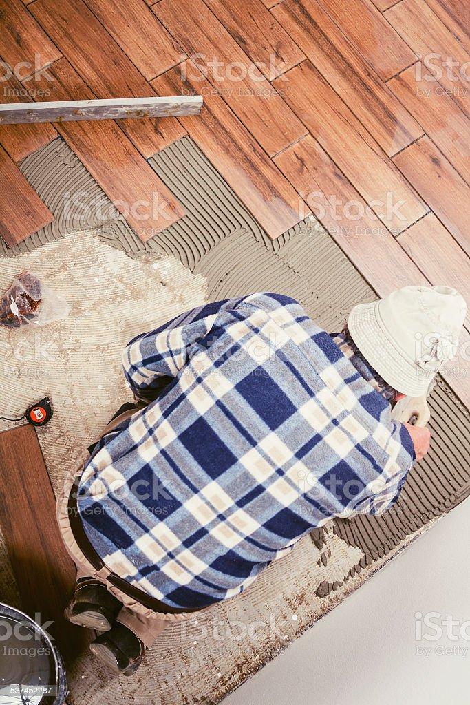 Laying ceramic tiles stock photo