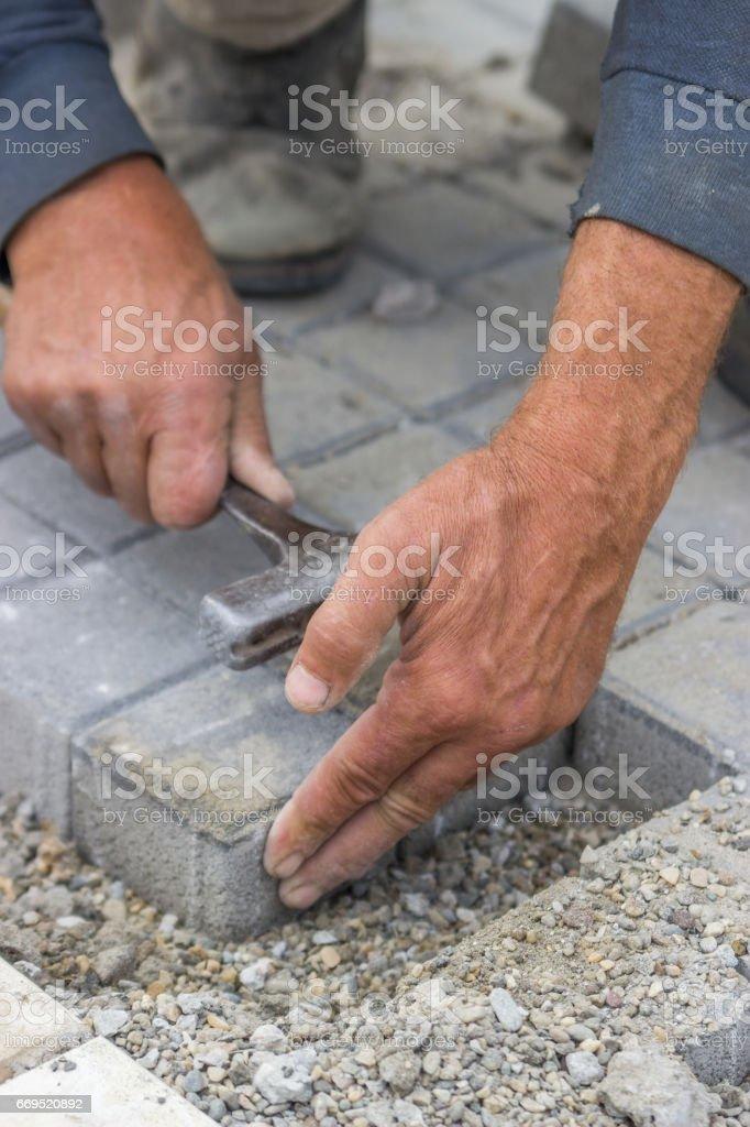 laying concrete brick pavers 3 stock photo