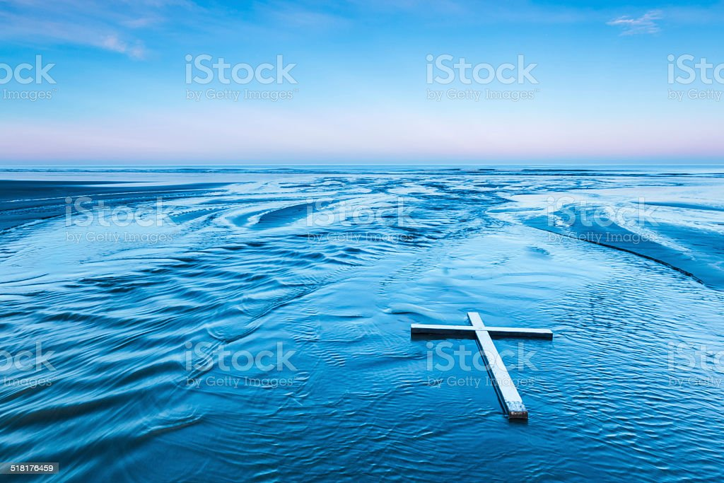 Laying Down White Cross stock photo