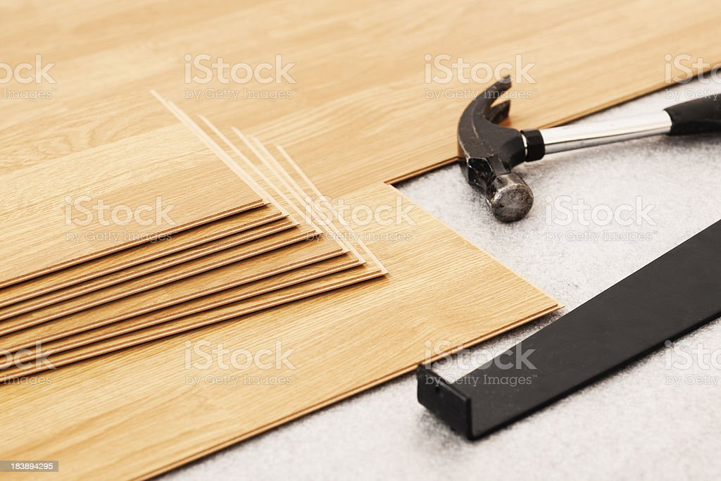 Laying laminate flooring still life with tools royalty-free stock photo