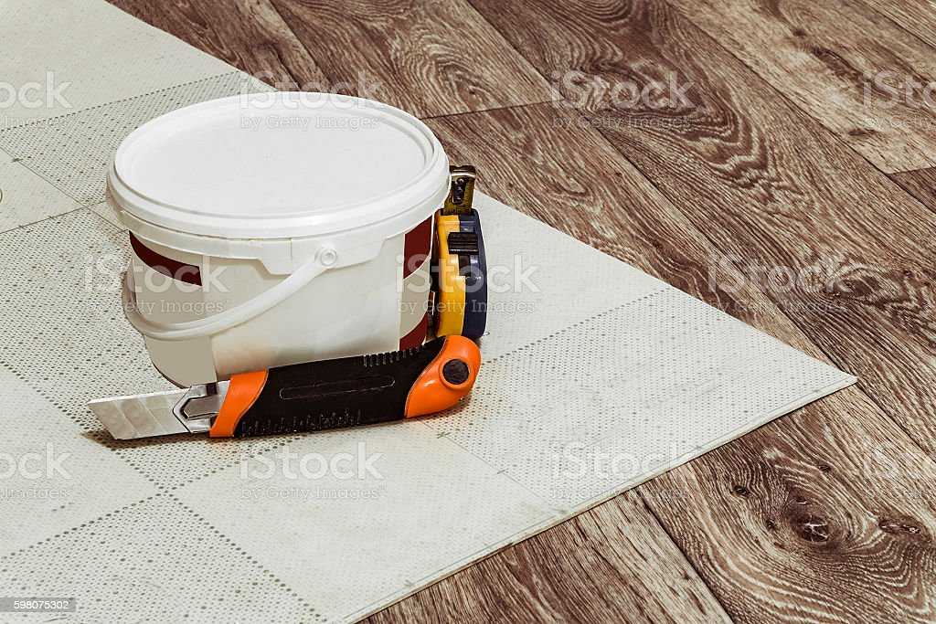 Laying linoleum flooring stock photo
