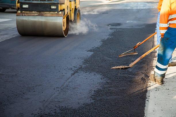 Sdraiati nuovo livello di asfalto - foto stock