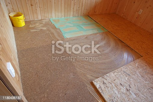 istock Laying of new parquet flooring in progress 1130435132