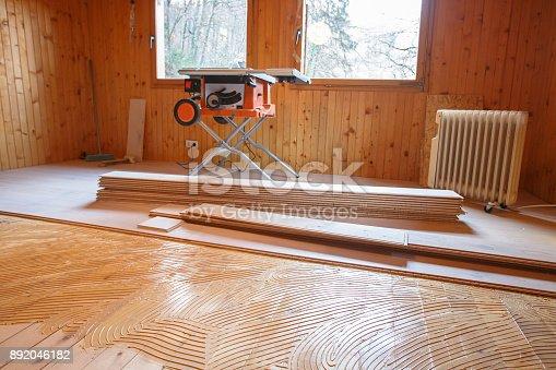 istock Laying of new parquet flooring in progress 892046182