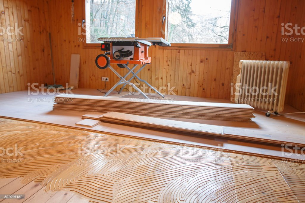 Laying of new parquet flooring in progress stock photo