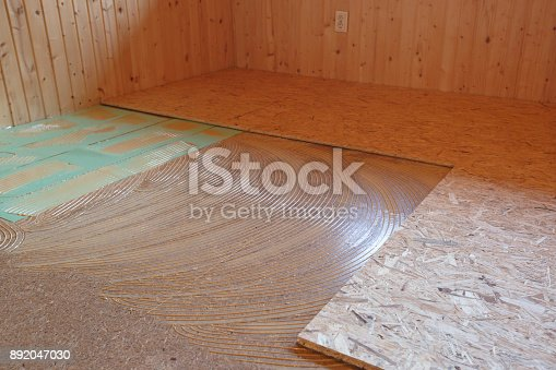 istock Laying of new parquet flooring in progress 892047030