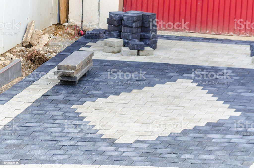 Laying of paving stones stock photo
