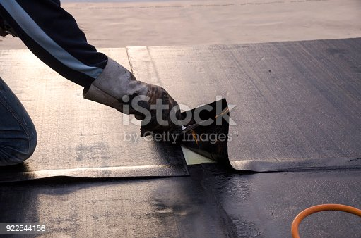 istock laying of waterproofing sheathing  and insulation on a roof 922544156