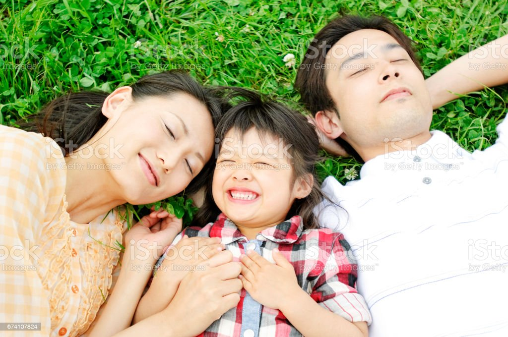 Laying on his back in the Park family royalty-free stock photo
