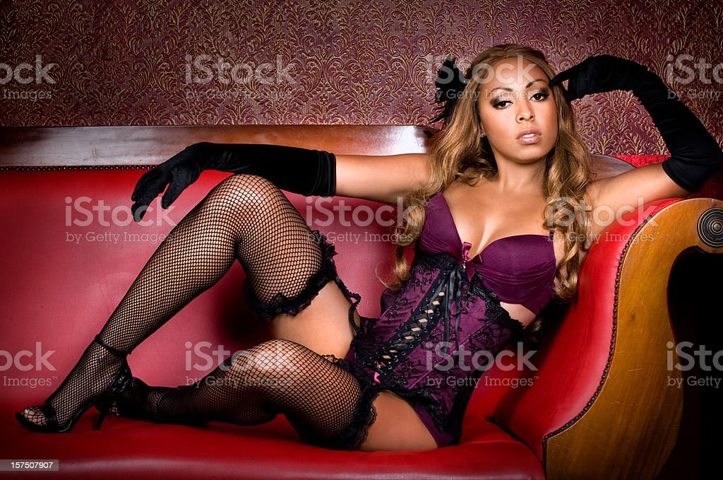laying on sofa sexy babe stock photo