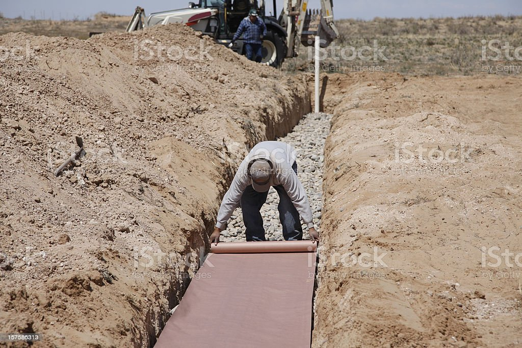 Laying Paper in a Drain Field on New Septic System stock photo