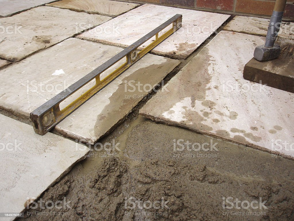laying patio flag paving slab stock photo