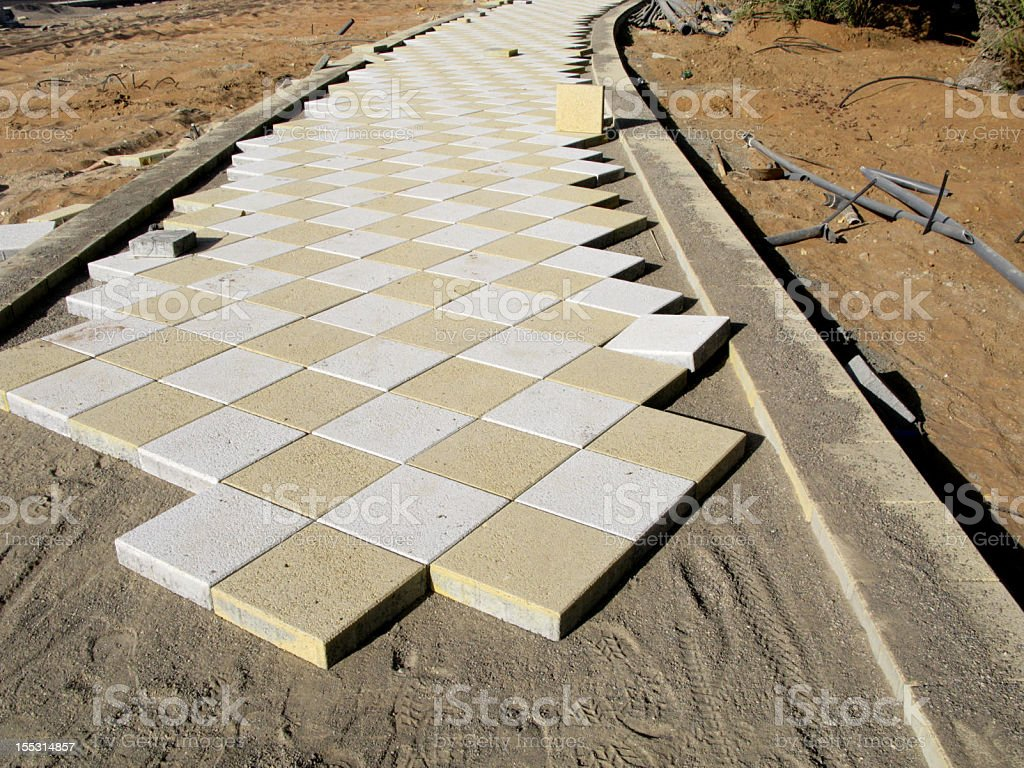 Laying Paving Slabs royalty-free stock photo