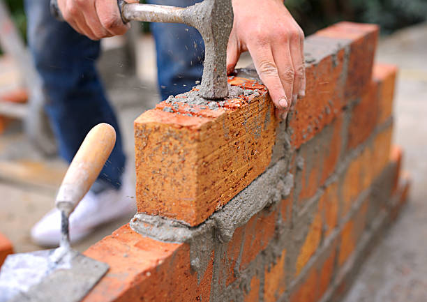 Laying the foundation one brick at a time stock photo