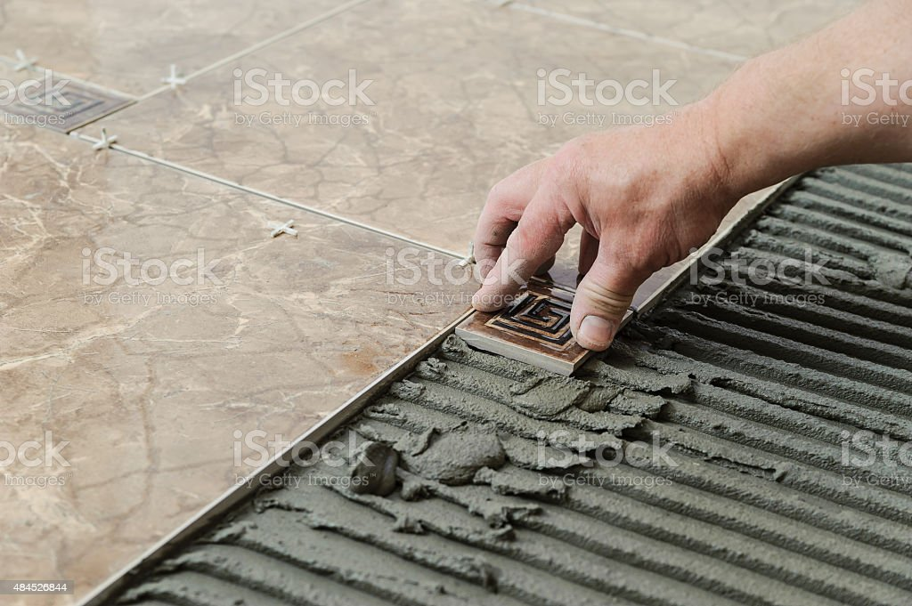 Laying the tiles stock photo