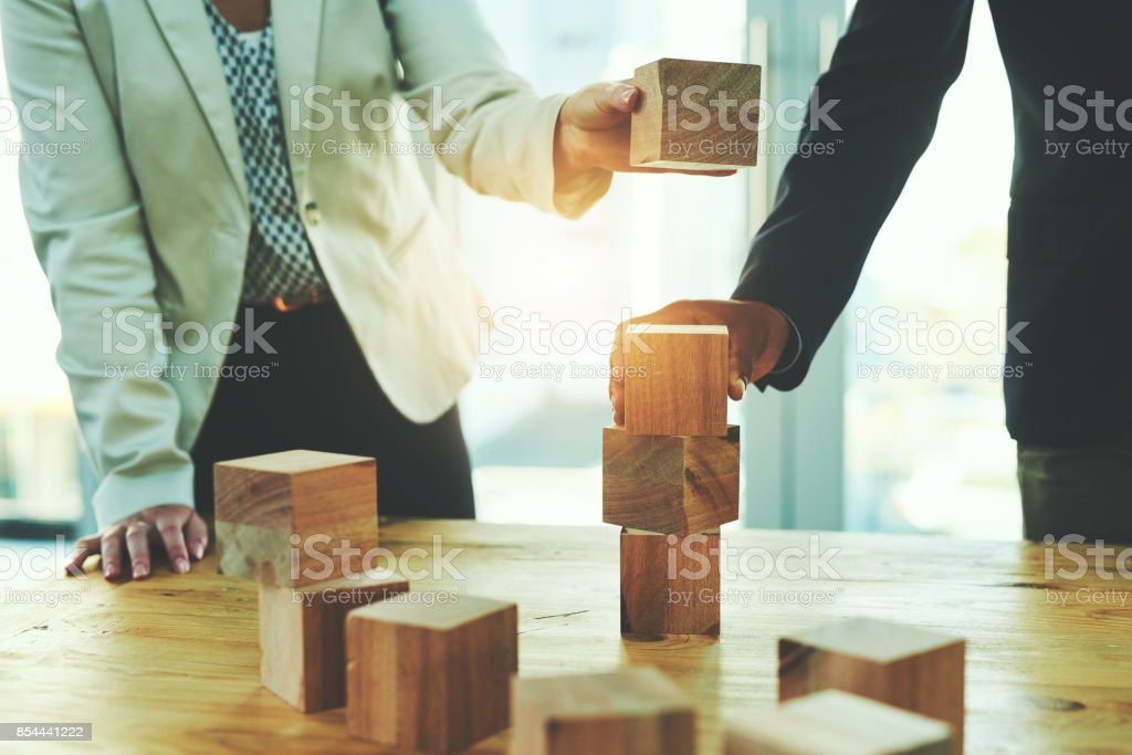 Laying their success on a solid and stable foundation stock photo