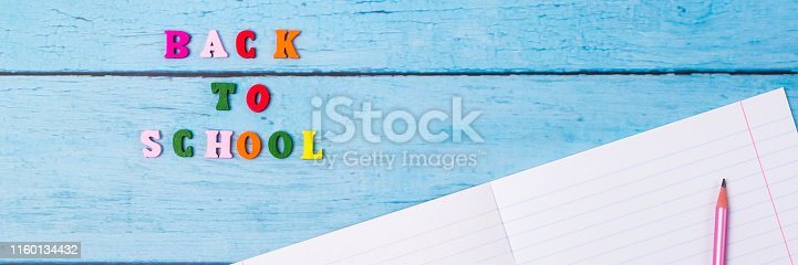 istock Layout of school supplies on a blue wooden background. The view from the top. Back to school. Flat lay. 1160134432