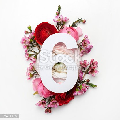 istock Layout with colorful flowers, leaves and number six. Flat lay. Top view. 924111186