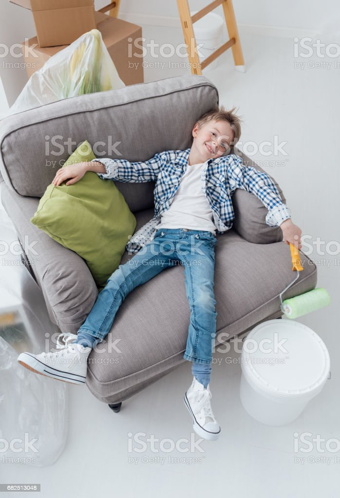 Lazy boy with paint roller royalty-free stock photo