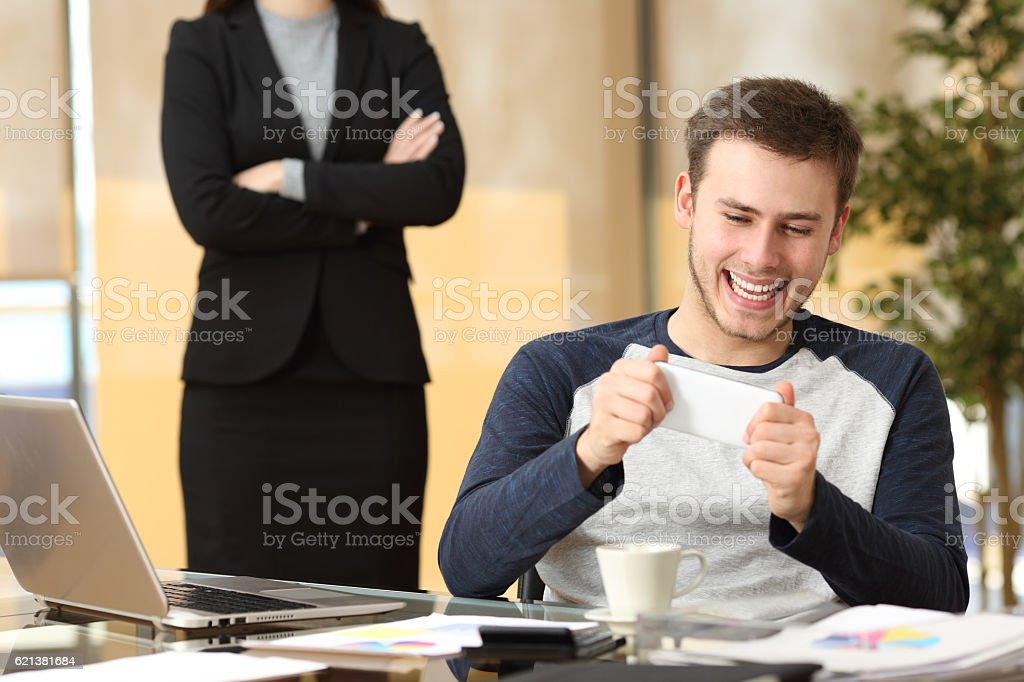Lazy employee with his angry boss watching stock photo