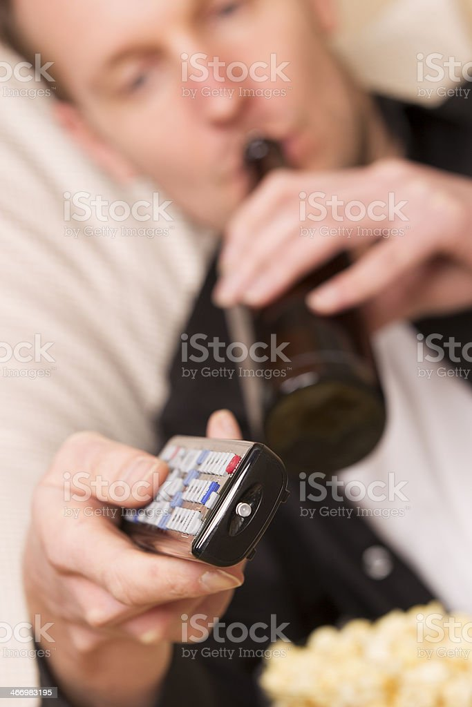 Lazy man drinking beer royalty-free stock photo