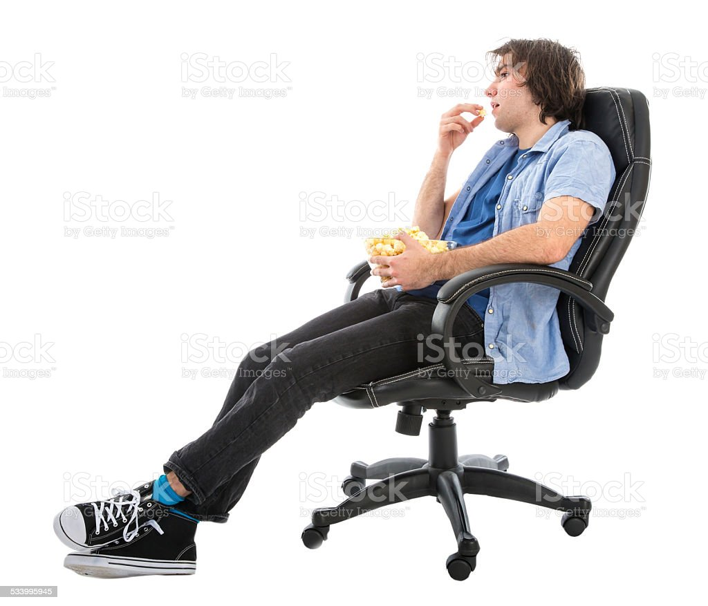 https://media.istockphoto.com/photos/lazy-man-sitting-in-armchair-eating-pop-corn-picture-id533995945