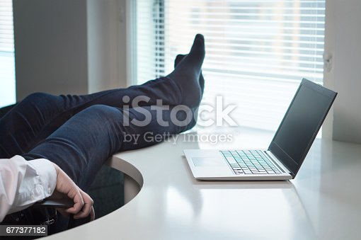 Lazy Office Worker With Feet And Socks On Table Useless