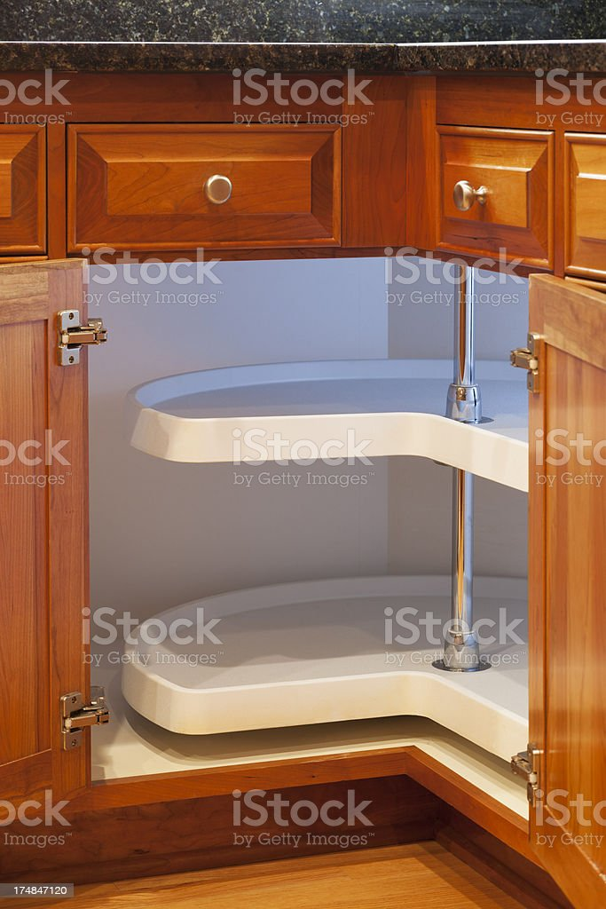 lazy susan custom cabinet in cherry stock photo