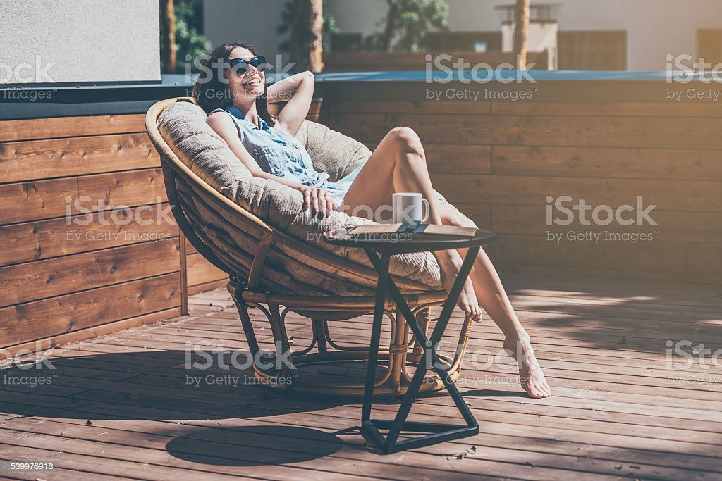Lazy time in comfortable chair. - foto de stock