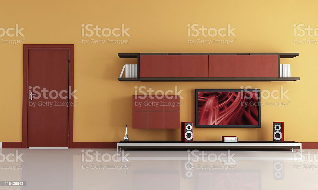 lcd tv and audio system in a orange  lounge royalty-free stock photo