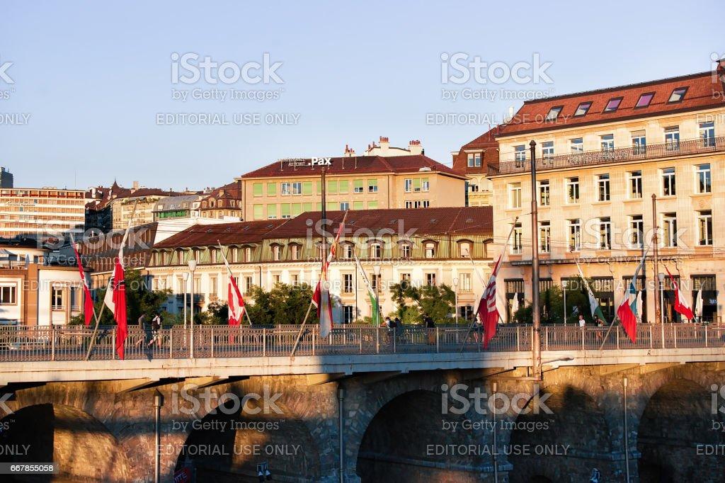 Le Flon district with Grand pont bridge with flags Lausanne stock photo