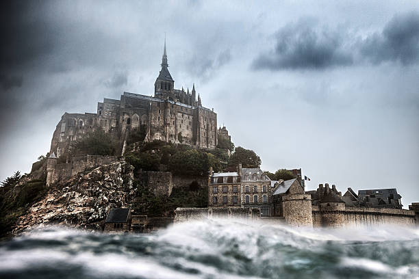 le mont saint michel in normandy france - castle stock photos and pictures