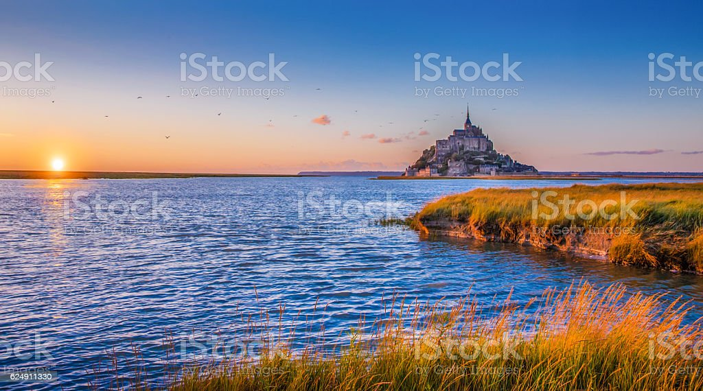Le Mont Saint-Michel at sunset, Normandy, France stock photo