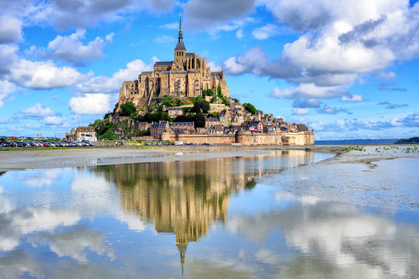 Le Mont-Saint-Michel island, Normandy, France Le Mont-Saint-Michel island with historical monastery reflecting in tidal water, Normandy, France abbey monastery stock pictures, royalty-free photos & images