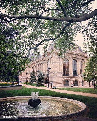 Paris, France - April 29, 2018: Le Petit Palais, Museum and park with few people walking under light rain