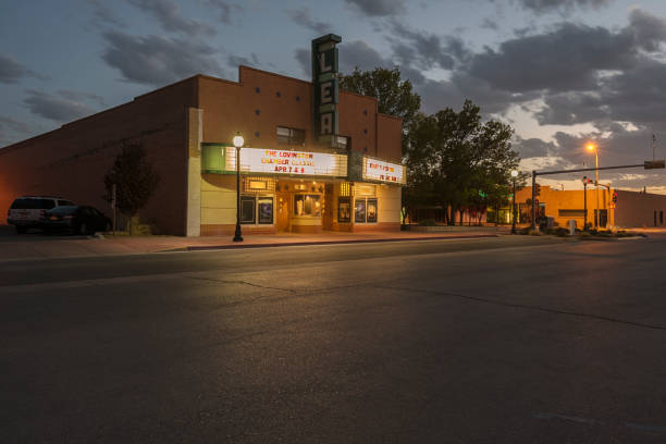 Lea Theater in Lovington, New Mexico Lovington, New Mexico - April 08,2018:  This evening photograph is of the Lea Movie Theater in  New Mexico.  It is located in the downtown district of the small city of Lovington. theater marquee commercial sign stock pictures, royalty-free photos & images