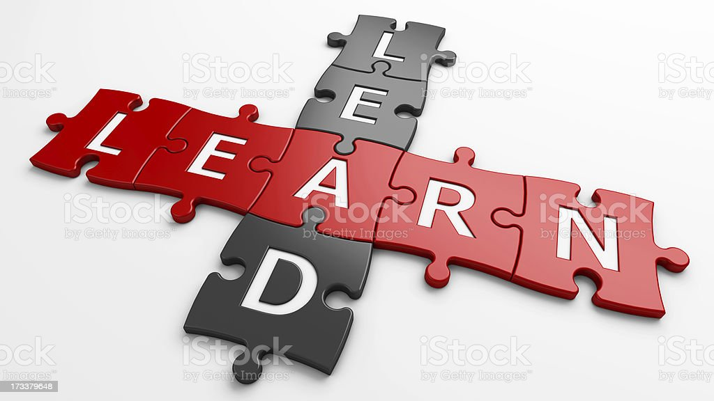 Lead and learn written on red and black jigsaw pieces stock photo