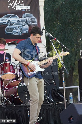 Gainesville USA - October 1, 2016: Lead guitarist in the battle of the bands competition. The event was held on public property with no photo restrictions.