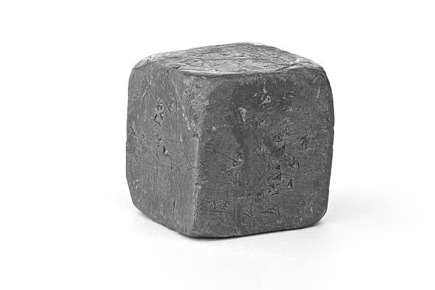 Lead metal cube isolated on white stock photo