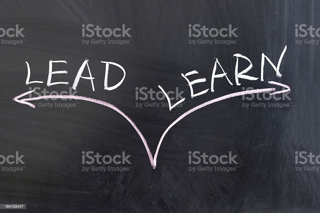 Lead or learn stock photo