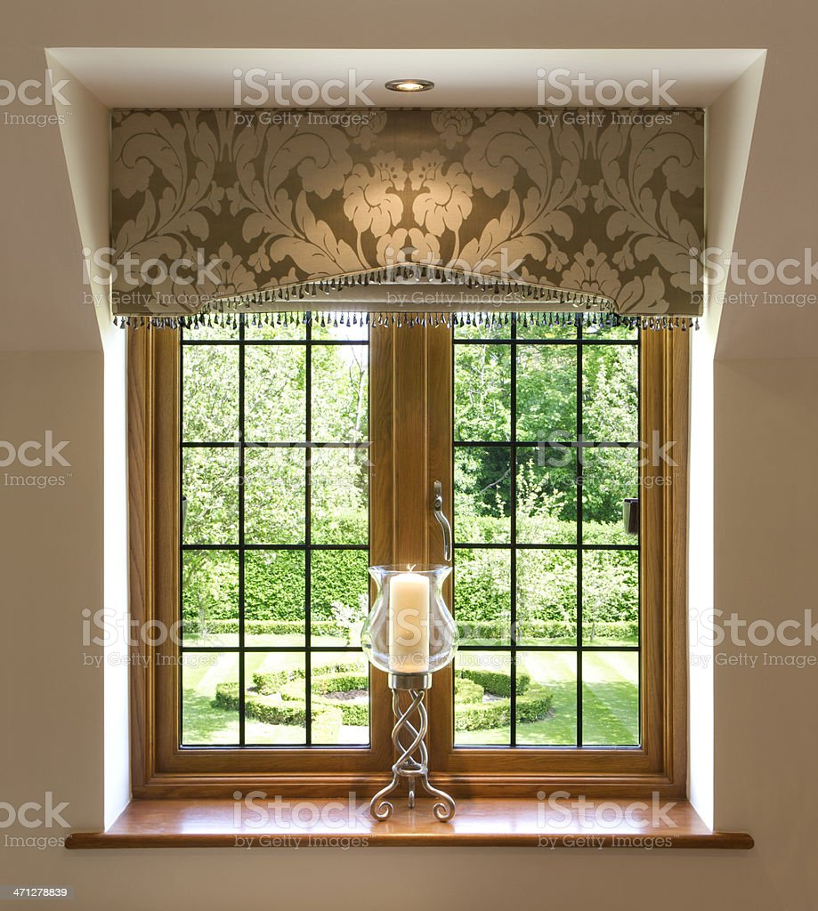 leaded glass window and candle royalty-free stock photo
