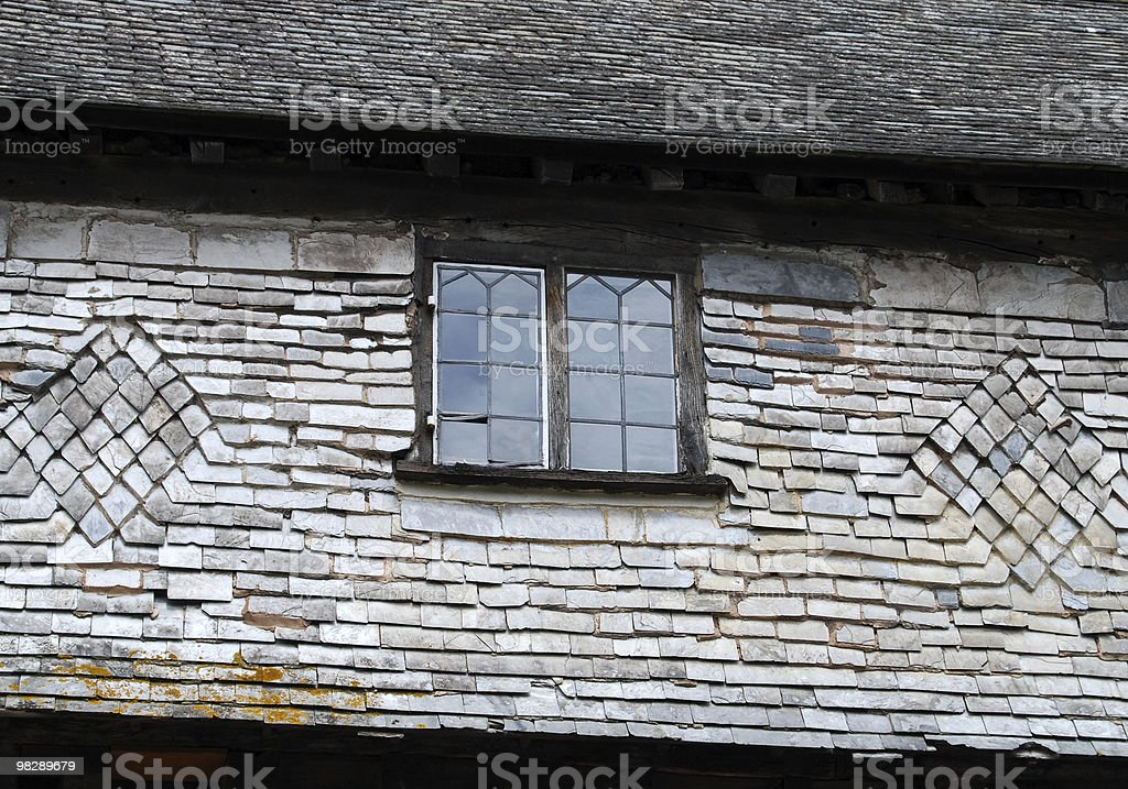 Leaded Window in Slate Roof royalty-free stock photo