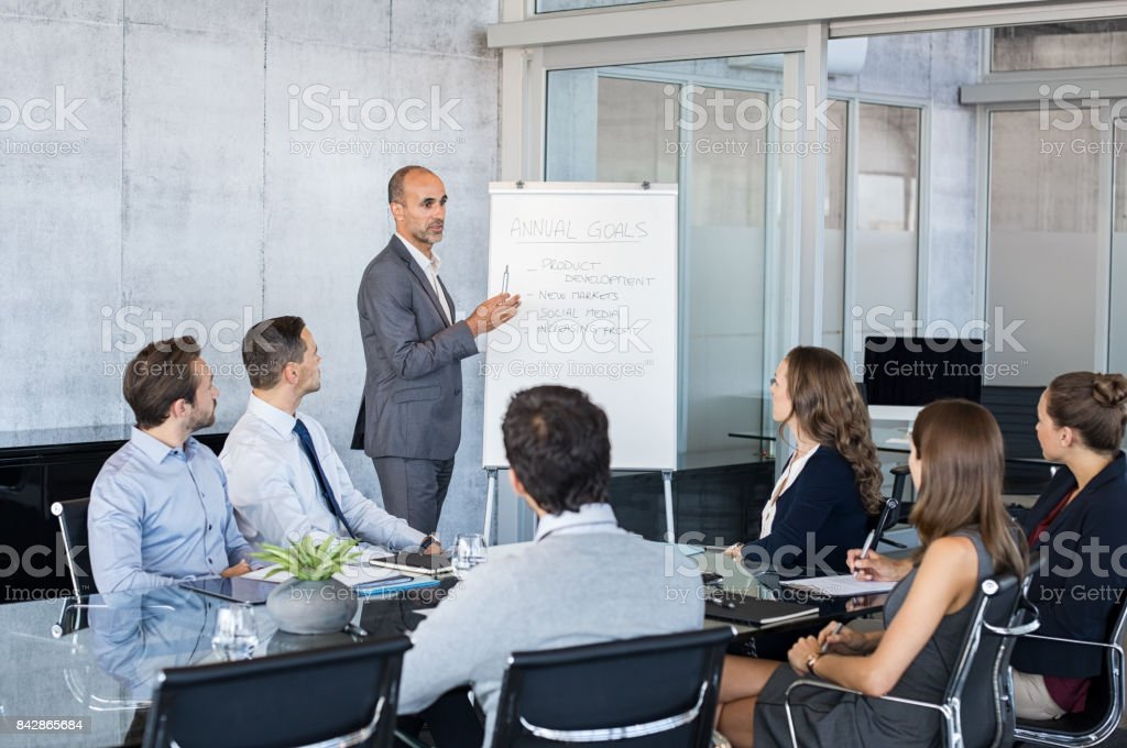 Leader briefing business people stock photo