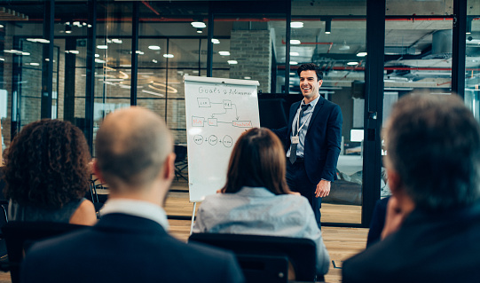 Businessman giving flipchart business presentation