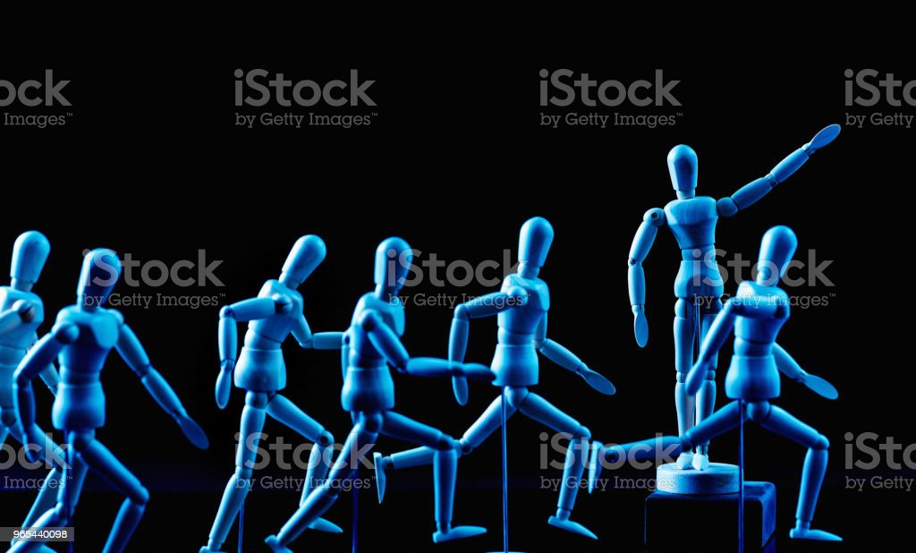 Leader encourages his followers forward royalty-free stock photo