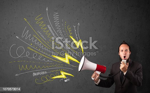 istock Leader guy shouting into megaphone with hand drawn lines and arrows 1070573014
